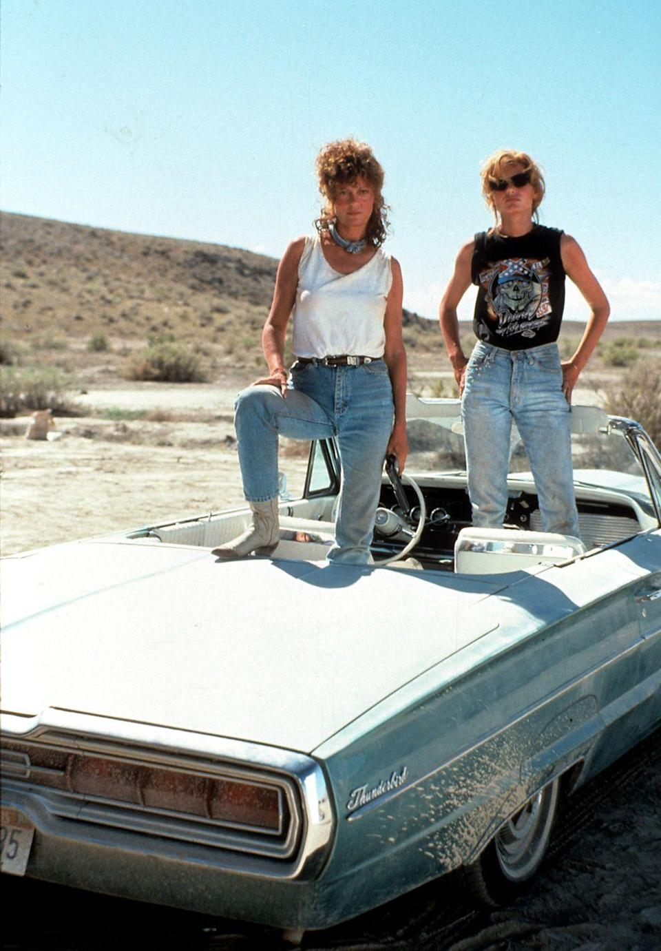 <p>In light wash jeans to match their Thunderbird, Thelma (Geena Davis) and Louise (Susan Sarandon) are the ultimate style goals in this '90s film. Not pictured: A young, denim-clad Brad Pitt — enough said. </p>