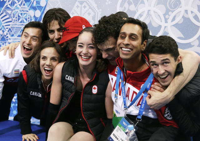 Kaetlyn Osmond of Canada, centre, waits for her results in the women's team short program figure skating competition at the Iceberg Skating Palace during the 2014 Winter Olympics, Saturday, Feb. 8, 2014, in Sochi, Russia. (AP Photo/Darron Cummings, Pool)