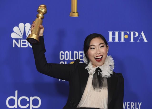 """Awkwafina poses in the press room with the award for best performance by an actress in a motion picture, musical or comedy for """"The Farewell"""" at the 77th annual Golden Globe Awards at the Beverly Hilton Hotel on Sunday, Jan. 5, 2020, in Beverly Hills, Calif. (AP Photo/Chris Pizzello)"""