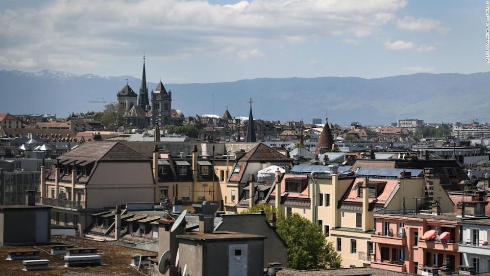 "<p>A 2019 file photo shows the St. Pierre Cathedral overlooking the roofs in the center of Geneva, Switzerland.</p><div class=""cnn--image__credit""><em><small>Credit: Fabrice Coffrini/AFP/Getty Images / Getty</small></em></div>"