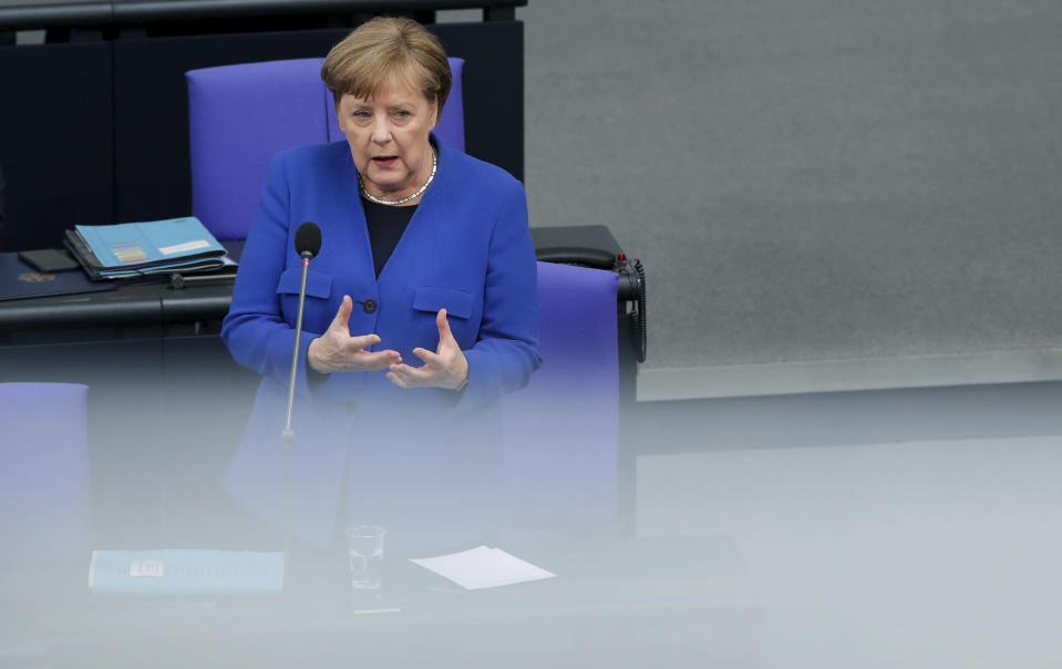 German Chancellor Angela Merkel takes questions as part of a meeting of the German federal parliament, Bundestag, at the Reichstag building in Berlin, Germany, Wednesday, May 13, 2020. (AP Photo/Michael Sohn)