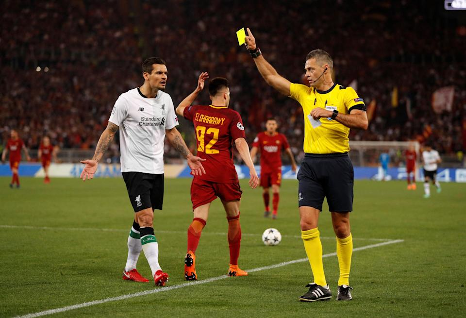 <p>Soccer Football – Champions League Semi Final Second Leg – AS Roma v Liverpool – Stadio Olimpico, Rome, Italy – May 2, 2018 Liverpool's Dejan Lovren is shown a yellow card by referee Damir Skomina Action Images via Reuters/John Sibley </p>