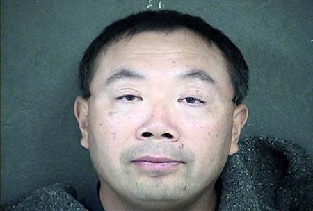 Zhang Weiqiang is shown in this Wyandotte County Detention Center handout photo released to Reuters December 12, 2013. REUTERS/Wyandotte County Detention Center