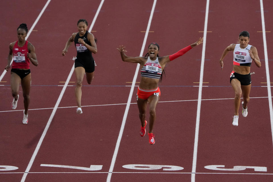 Gabby Thomas celebrates after winning the final in the women's 200-meter run at the U.S. Olympic Track and Field Trials Saturday, June 26, 2021, in Eugene, Ore. (AP Photo/Chris Carlson)