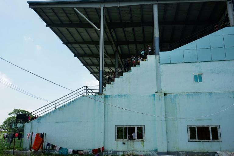 Hundreds of traumatised Hindus now sleep on grubby mats in the overcrowded concourse of a disused football stadium in Sittwe