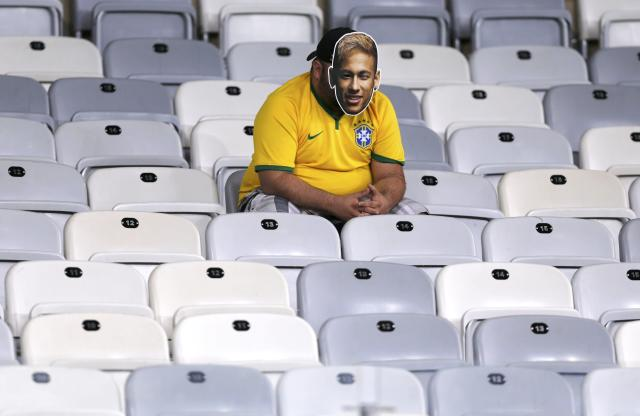 A fan dressed as Brazil's Neymar sits in an empty stand after the 2014 World Cup semi-finals between Brazil and Germany at the Mineirao stadium in Belo Horizonte July 8, 2014. REUTERS/Marcos Brindicci (BRAZIL - Tags: TPX IMAGES OF THE DAY SOCCER SPORT WORLD CUP)