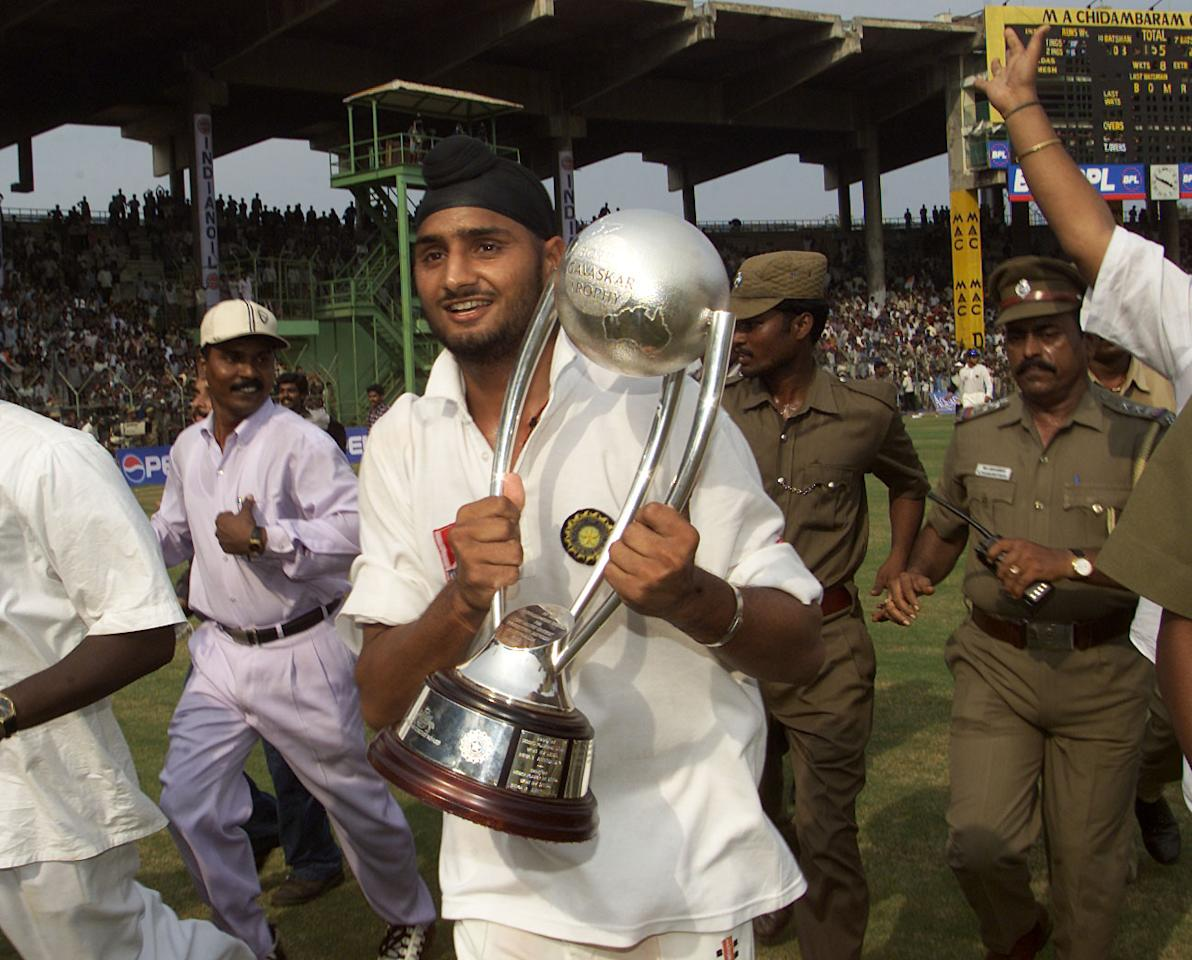 22 Mar 2001:  Harbhajan Singh of India runs with the trophy during a lap of honour, after India won the series, during day five of the third test between India and Australia at the M.A. Chidambaram Stadium, Chennai, India. India won the Test by two wickets and the series 2 -1  X DIGITAL IMAGE  Mandatory Credit: Hamish Blair/ALLSPORT