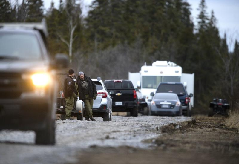 Personnel work at the site of a fatal plane crash in Kingston, Ontario, in Canada. | Sean Kilpatrick/The Canadian Press via AP