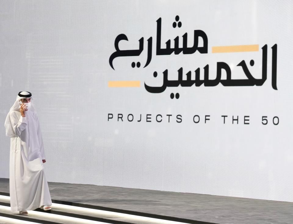 Emirati Minister of State for Foreign Trade Thani bin Ahmed al-Zeyoudi speaks on his mobile phone before an event announcing new economic programs in the United Arab Emirates in Dubai, United Arab Emirates, Sunday, Sept. 5, 2021. The United Arab Emirates announced Sunday a major plan to stimulate its economy and liberalize stringent residency laws for expatriates, as the country seeks to overhaul its finances and attract foreign residents and capital. (AP Photo/Jon Gambrell)