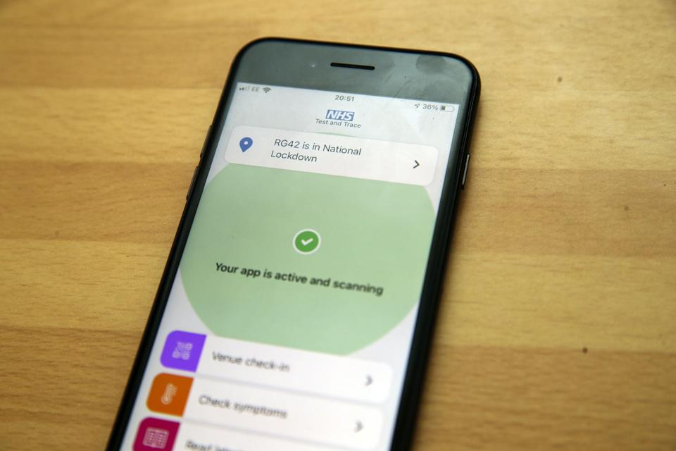 The NHS app on a smartphone (PA Wire)