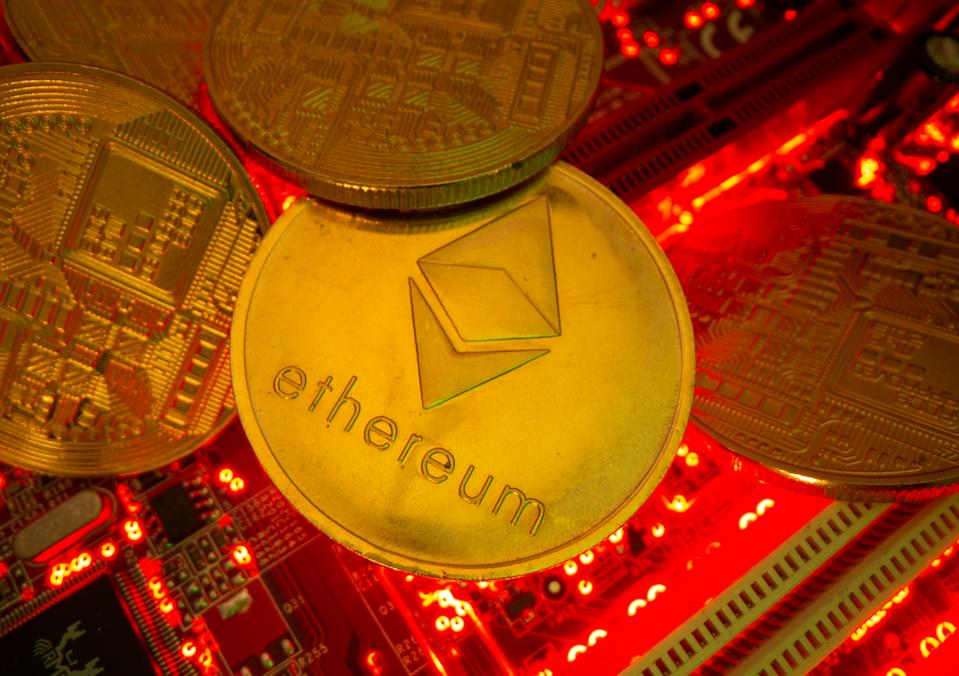 Representations of the virtual currency Ethereum stand on a motherboard in this picture illustration taken May 20, 2021. REUTERS/Dado Ruvic/Illustration