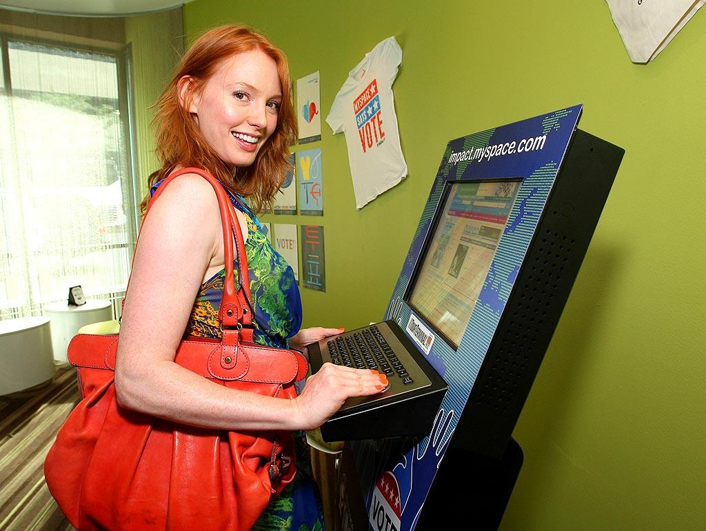 "Alicia Witt stays connected at the MySpace Cafe. John Shearer/<a href=""http://www.wireimage.com"" target=""new"">WireImage.com</a> - August 27, 2008"