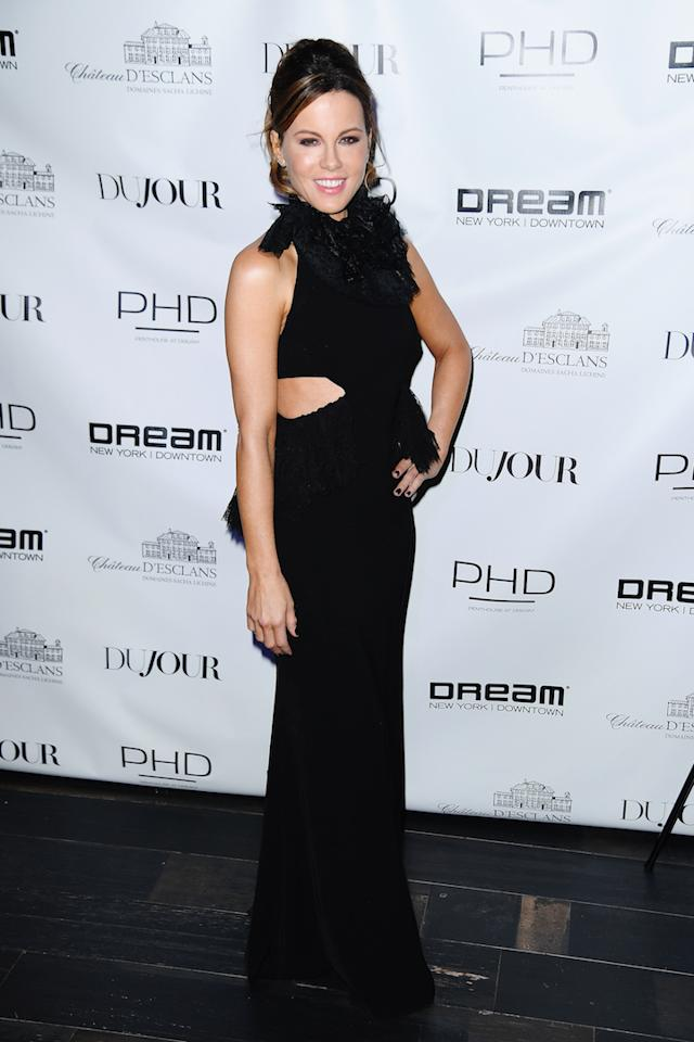 <p>Actress Kate Beckinsale attended a DuJour magazine party on February 28 in a black cut-out dress. <em>[Photo: Getty]</em> </p>