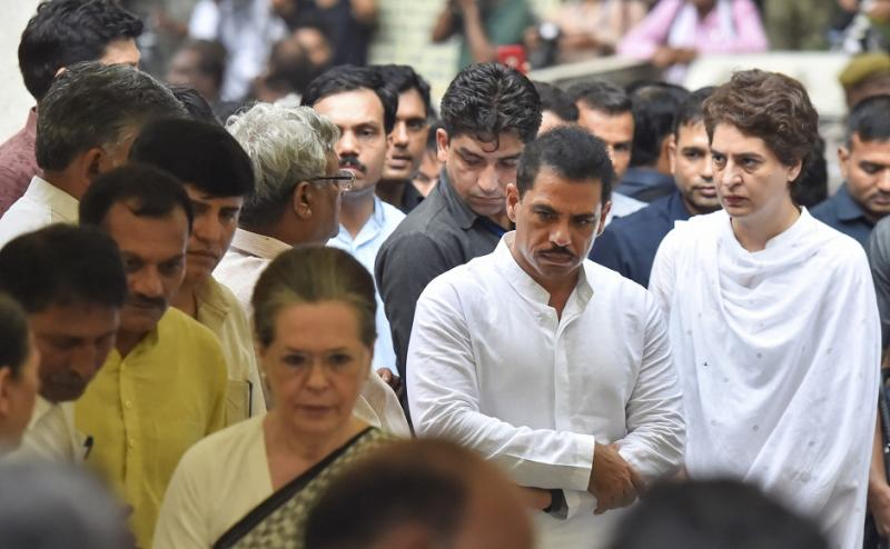 Family members, colleagues, Congress workers, and admirers braved heavy rains and gusty winds to bid her a final farewell at the national capital's oldest cremation ground, Nigambodh Ghat. PTI