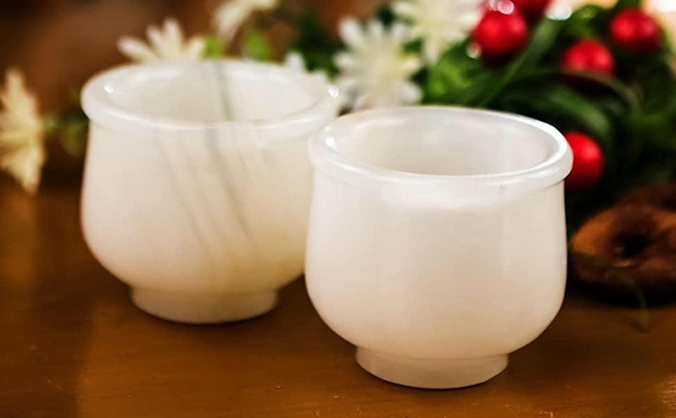 <p>How stunning are these <span>White Onyx Shot Glasses Sake Cups</span> ($9)!?</p>