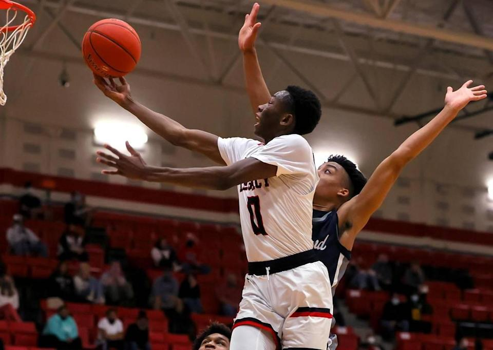 Mansfield Legacy guard Wayne Wiggins (0) goes to the basket for two points against Richland guard Jourdyn Grandberry during the first half of a 5A Region 1 Boys Basketball Area-Round 2 playoff game played on February 24, 2021 at Burleson High School. (Steve Nurenberg Special to the Star-Telegram)