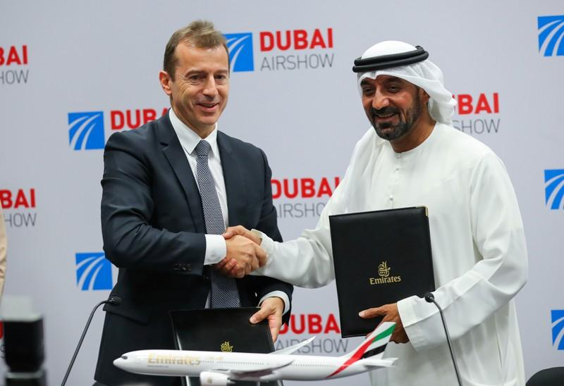 Sheikh Ahmed bin Saeed Al Maktoum, CEO and chairman of the Emirates Group and Guillaume Faury, Chief Executive Officer for Airbus shake hands at press conference during the second day of Dubai Air Show in Dubai