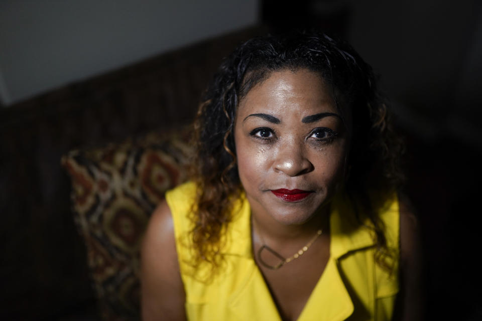 Daphne Bolton poses for a portrait at her home on Monday, May 31, 2021, in Charlotte, N.C. Bolton's brother, Johnny Lorenzo Bolton, a 49-year-old Black man was shot to death by a Cobb County Sheriff's Office SWAT team member serving a search warrant last December. (AP Photo/Chris Carlson)