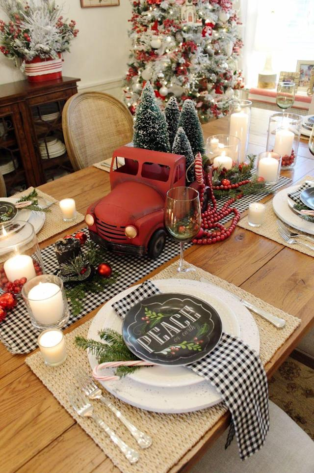 """<p>With its gingham base, array of bottlebrush trees, and rustic red truck, this tablescape proves there's nothing more fun than Christmas in the country. </p><p><strong>Get the tutorial at <a href=""""https://rosemary-thyme.blogspot.com/2017/11/a-country-christmas-tablescape.html"""" rel=""""nofollow noopener"""" target=""""_blank"""" data-ylk=""""slk:Rosemary and Thyme"""" class=""""link rapid-noclick-resp"""">Rosemary and Thyme</a>.</strong></p><p><strong><a href=""""https://www.amazon.com/Red-Metal-Truck/dp/B01HN59JJ2/"""" rel=""""nofollow noopener"""" target=""""_blank"""" data-ylk=""""slk:SHOP RED TRUCKS"""" class=""""link rapid-noclick-resp"""">SHOP RED TRUCKS</a><br></strong></p>"""