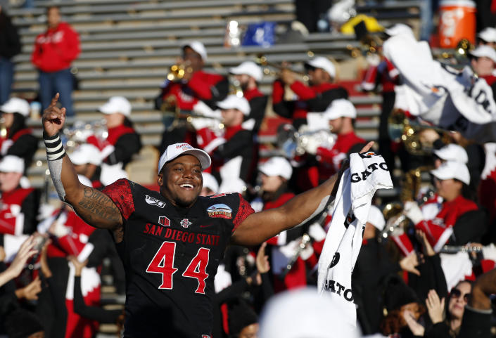 San Diego State linebacker Kyahva Tezino (44) celebrates after his team beat Central Michigan in the New Mexico Bowl NCAA college football game on Saturday, Dec. 21, 2019 in Albuquerque, N.M. (AP Photo/Andres Leighton)