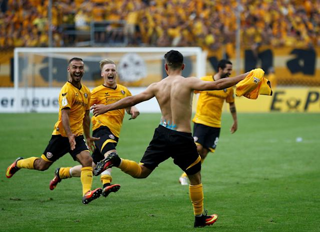 Football Soccer - Dynamo Dresden v RB Leipzig - German Cup (DFB Pokal) - DDV-Stadion, Dresden, Germany - 20/08/16. Dynamo Dresden's Aias Aosman and his team mates celebrate after he scored the final penalty. REUTERS/Axel Schmidt. DFB RULES PROHIBIT USE IN MMS SERVICES VIA HANDHELD DEVICES UNTIL TWO HOURS AFTER A MATCH AND ANY USAGE ON INTERNET OR ONLINE MEDIA SIMULATING VIDEO FOOTAGE DURING THE MATCH.