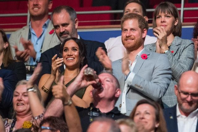 Harry and Meghan at the Invictus Games closing ceremony last year