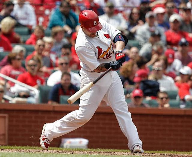 St. Louis Cardinals Yadier Molina hits an RBI single during the sixth inning of a baseball game against the Chicago Cubs Thursday, May 15, 2014, in St. Louis. (AP Photo/Sarah Conard)