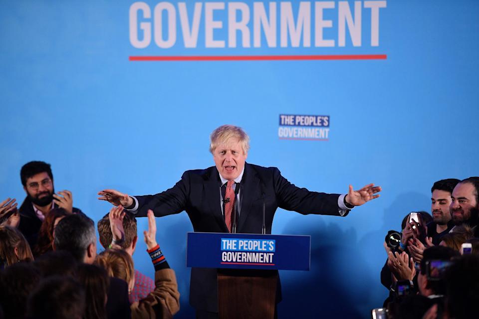 """TOPSHOT - Britain's Prime Minister and leader of the Conservative Party, Boris Johnson speaks during a campaign event to celebrate the result of the General Election, in central London on December 13, 2019. - Prime Minister Boris Johnson on Friday hailed a political """"earthquake"""" after securing a sweeping election win, which clears the way for Britain to finally leave the European Union next month after years of political deadlock. (Photo by DANIEL LEAL-OLIVAS / AFP) (Photo by DANIEL LEAL-OLIVAS/AFP via Getty Images)"""