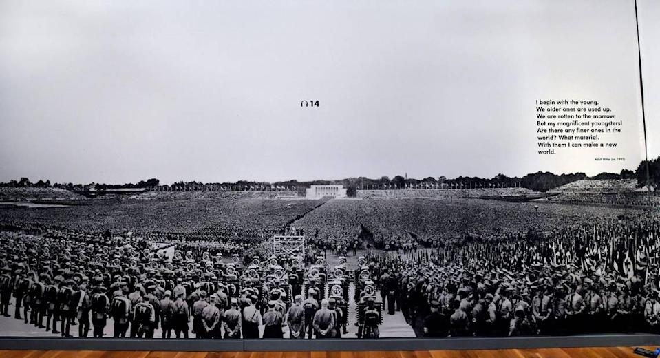 The exhibition includes a giant photograph taken at a Nazi rally in Nuremberg, Germany, during World War II.