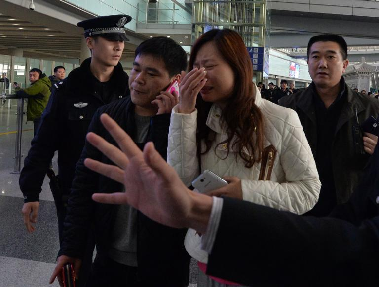 A possible relative cries at the Beijing Airport after news of the missing Malaysia Airlines Boeing 777-200 plane in Beijing on March 8, 2014