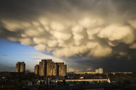 Clouds cover the sky over the Ernst-Taehlmann-Park housing estate after a thunderstorm in Berlin, Germany, Thursday, March 11, 2021. (AP Photo/Markus Schreiber)
