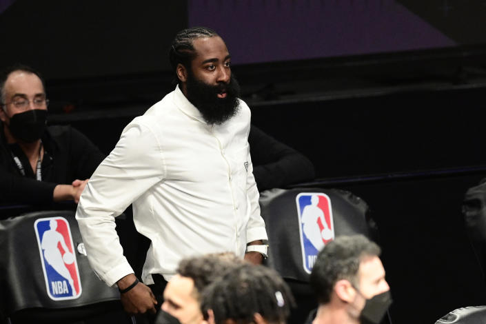 NEW YORK, NEW YORK - JUNE 07:  James Harden #13 of the Brooklyn Nets looks on from the sideline against the Milwaukee Bucks in Game Two of the Second Round of the 2021 NBA Playoffs at Barclays Center on June 07, 2021 in New York City. NOTE TO USER: User expressly acknowledges and agrees that, by downloading and or using this photograph, User is consenting to the terms and conditions of the Getty Images License Agreement. (Photo by Steven Ryan/Getty Images)