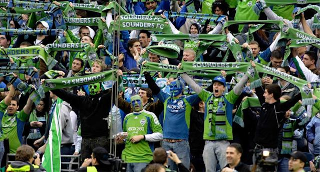 Fans show their Sounders pride at Seattle's inaugural MLS match against the Red Bulls. (AP Photo)
