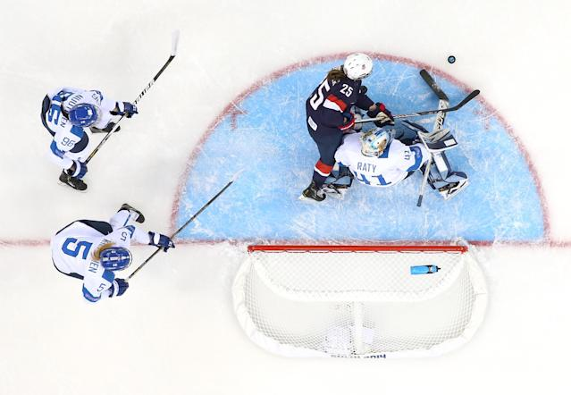 SOCHI, RUSSIA - FEBRUARY 08: Noora Raty #41 of Finland tends goal against Alex Carpenter #25 of United States during the Women's Ice Hockey Preliminary Round Group A Game on day 1 of the Sochi 2014 Winter Olympics at Shayba Arena on February 8, 2014 in Sochi, Russia. (Photo by Martin Rose/Getty Images)