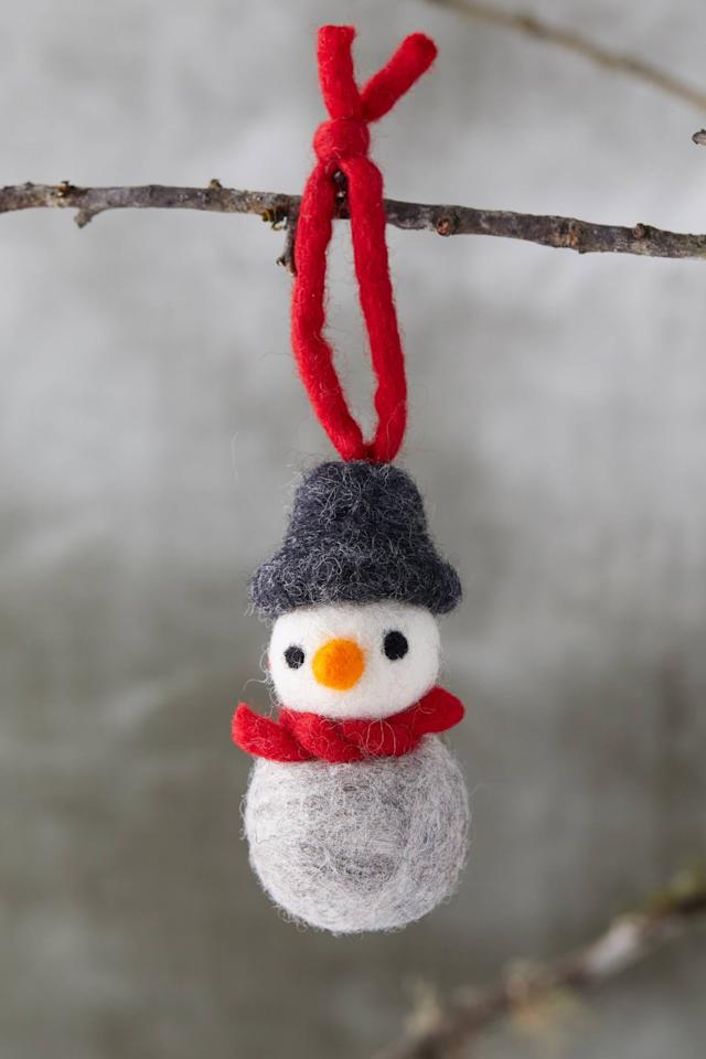 "<p>This adorable <a href=""https://www.popsugar.com/buy/Felted-Wool-Snowman-Ornament-502215?p_name=Felted%20Wool%20Snowman%20Ornament&retailer=anthropologie.com&pid=502215&price=10&evar1=casa%3Aus&evar9=46615300&evar98=https%3A%2F%2Fwww.popsugar.com%2Fhome%2Fphoto-gallery%2F46615300%2Fimage%2F46767573%2FFelted-Wool-Snowman-Ornament&list1=shopping%2Canthropologie%2Choliday%2Cchristmas%2Cchristmas%20decorations%2Choliday%20decor%2Chome%20shopping&prop13=mobile&pdata=1"" rel=""nofollow"" data-shoppable-link=""1"" target=""_blank"" class=""ga-track"" data-ga-category=""Related"" data-ga-label=""https://www.anthropologie.com/shop/felted-wool-snowman-ornament?category=holiday-gifts-ornaments-decor&amp;color=004"" data-ga-action=""In-Line Links"">Felted Wool Snowman Ornament</a> ($10) is handmade and makes a darling decoration. </p>"