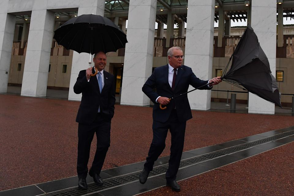 CANBERRA, AUSTRALIA - OCTOBER 07: Treasurer Josh Frydenberg and Prime Minister Scott Morrison arrives for media appearances in the forecourt lawn at Parliament House on October 07, 2020 in Canberra, Australia. The Morrison government's second budget was published on Tuesday, after its release in May was delayed by the COVID-19 pandemic. Treasurer Frydenberg has delivered a federal budget deficit of $213.7 billion in the wake of coronavirus and related shutdowns, with a number of tax cuts to be introduced to help boost the economy and create jobs as Australia experiences its first recession in 29 years.  (Photo by Sam Mooy/Getty Images)