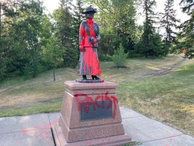 Edmonton's Emily Murphy statue was covered in red paint and the word 'racist' written over a plaque below the statue.  (Jamie McCannel/CBC News - image credit)