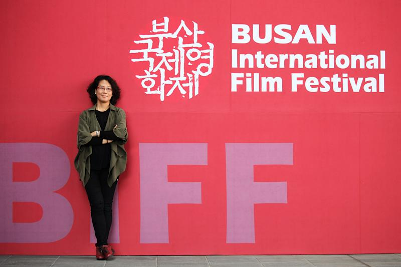 "In this Oct. 4, 2013 photo, South Korean Director Kim Lyang poses during an interview with the Associated Press at Busan Cinema Center in Busan, South Korea. Kim's ""Dream House by the Border"" is one of 11 documentary features competing for a 10 million won ($9,300) prize at the Busan International Film Festival. (AP Photo/Woohae Cho)"