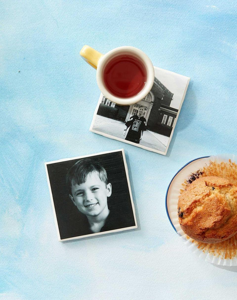 """<p>Mom will enjoy her morning cup of tea even more when she looks down and sees her child's smiling face. Start by printing a photo (either in black & white or color) on card stock paper that is 1/4-inch smaller than a glazed white tile. Brush the back of the photo with glossy Mod Podge and place on the tile, making sure it's centered. Brush the top of the photo with Mod Podge to seal. Allow to dry completely.</p><p><a class=""""link rapid-noclick-resp"""" href=""""https://www.amazon.com/CS11201-Mod-Podge-8-Ounce-1-Pack/dp/B003W0XR8M/?tag=syn-yahoo-20&ascsubtag=%5Bartid%7C10050.g.4233%5Bsrc%7Cyahoo-us"""" rel=""""nofollow noopener"""" target=""""_blank"""" data-ylk=""""slk:SHOP MOD PODGE"""">SHOP MOD PODGE</a></p>"""