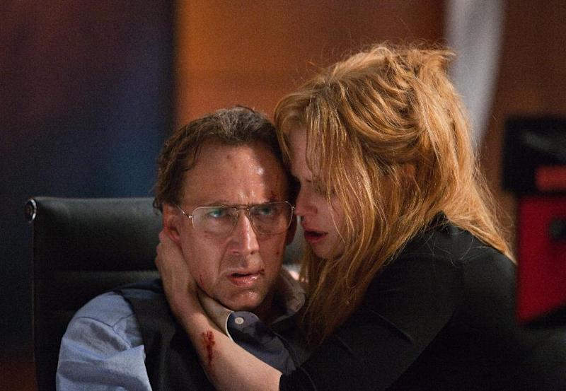 "In this image released by Millennium Entertainment, Nicole Kidman and Nicolas Cage, left, are shown in a scene from ""Trespass.""  The story of a family terrorized by home intruders, ""Trespass"" debuts Friday for a limited theatrical run in New York City, Los Angeles, Chicago and seven other major markets. It will be available at the same time for home viewing through video on demand. (AP Photo/Millennium Entertainment, Alan Markfield)"