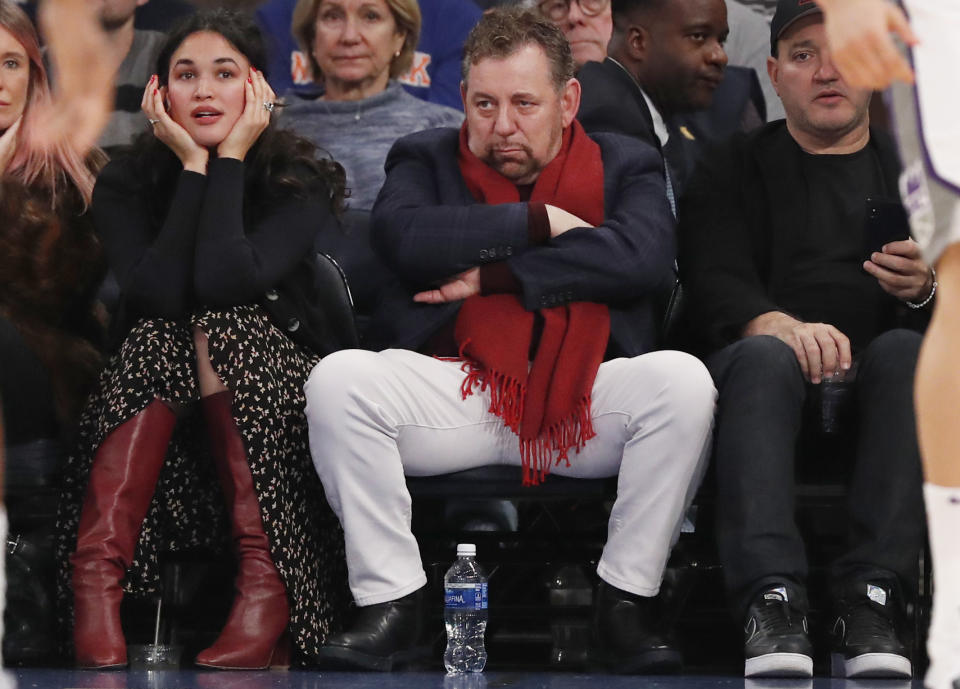 Executive chairman and Madison Square Garden CEO James Dolan, center, watches during the first half of an NBA basketball game between the New York Knicks and the Sacramento Kings in New York, Sunday, Nov. 3, 2019. The Kings defeated the Knicks 113-92. (AP Photo/Kathy Willens)