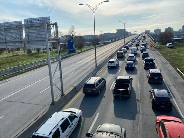 A line of drivers wait to enter Ontario on the Macdonald-Cartier Bridge, linking Ottawa and Gatineau, Que., on April 19, 2021, the first day of border checkpoints to enforce provincial rules.