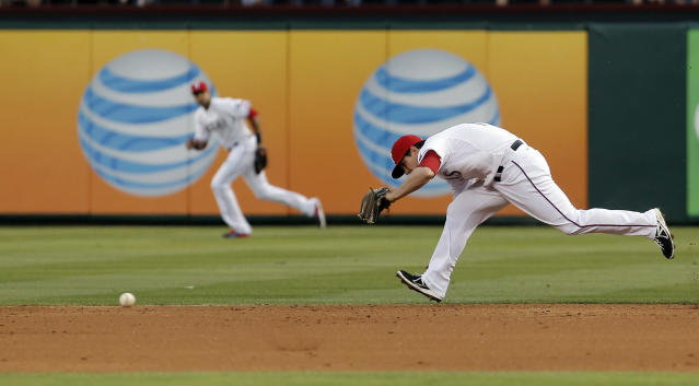 Texas Rangers second baseman Donnie Murphy (16) is unable to field a hit by Oakland Athletics John Jaso (5) during the second inning of a baseball game, Monday, April 28, 2014, in Arlington, Texas. (AP Photo/Brandon Wade)