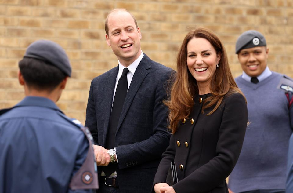 Britain's Prince William, Duke of Cambridge, and Britain's Catherine, Duchess of Cambridge, wearing black as a mark of respect following the death of Britain's Prince Philip, Duke of Edinburgh, talk with Air Cadets during their visit to 282 (East Ham) Squadron Air Training Corps in east London on April 21, 2021. - During the visit, the Squadron paid tribute to The Duke of Edinburgh, who served as Air Commodore-in-Chief of the Air Training Corps for 63 years. In 2015, The Duke passed the military patronage to The Duchess of Cambridge who became Honorary Air Commandant. (Photo by Ian Vogler / POOL / AFP) (Photo by IAN VOGLER/POOL/AFP via Getty Images)