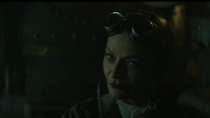 A still from Doom Patrol shows Michelle Gomez as Madame Rouge wearing a leather helmet with goggles attached