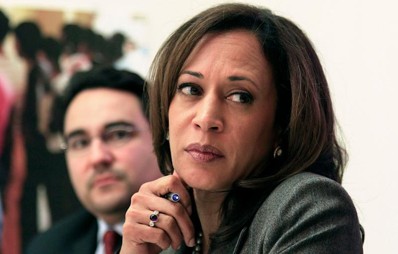 California Attorney General Kamala Harris, right, and Michael Troncoso, Senior Counsel to the Attorney General, left, listen as mortgage fraud victim Jacqueline Marcelos speaks at a roundtable of foreclosure victims at Mission Economic Development Agency in San Francisco, on Monday, Nov. 21, 2011. (AP Photo/Jeff Chiu)