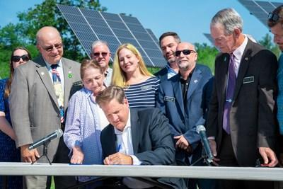 Gov. Sununu at a recent bill signing to expand net metering in New Hampshire