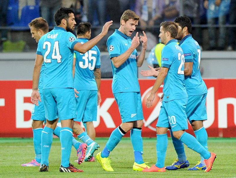 Zenit St Petersburg players celebrate a goal during their Champions League match against Standard Liege in St Petersburg on August 26, 2014