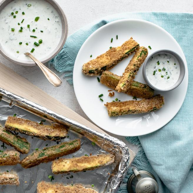 """<p>These easy oven-baked veggie fries are made from thick slices of zucchini dipped in a seasoned breadcrumb batter. Served with an herbed buttermilk dipping sauce, they're so good, you may just prefer them over regular potato fries! <a href=""""http://www.eatingwell.com/recipe/272213/oven-fried-zucchini-fries-with-herbed-buttermilk-dipping-sauce/"""" rel=""""nofollow noopener"""" target=""""_blank"""" data-ylk=""""slk:View recipe"""" class=""""link rapid-noclick-resp""""> View recipe </a></p>"""