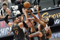 Chicago Bulls center Nikola Vucevic (9), forward Garrett Temple and center Daniel Theis (27) and Cleveland Cavaliers guard Collin Sexton, left, rear, and center Jarrett Allen (31) vie for a rebound during the first half of an NBA basketball game in Chicago, Saturday, April 17, 2021. (AP Photo/Nam Y. Huh)